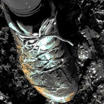 foot in mud, high contrast weird colour